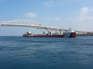 Ship downbound under the Blue Water Bridge in Port Huron